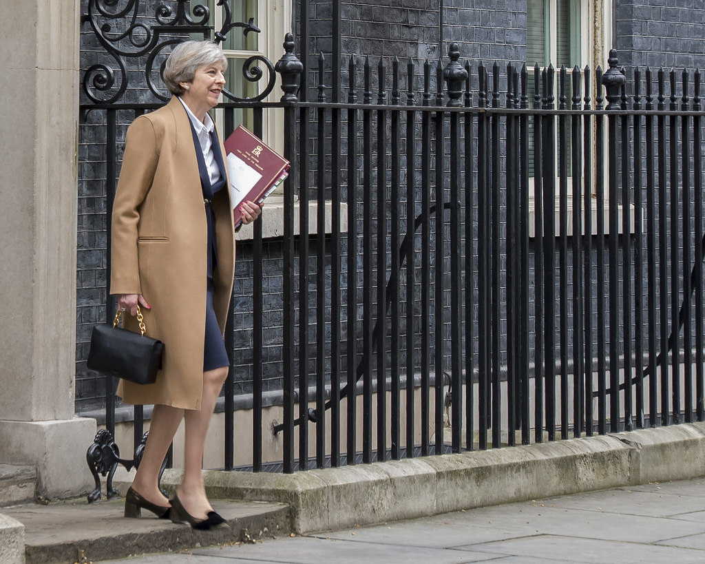TO PARLIAMENT. British Prime Minister Theresa May leaving 10 Downing Street to go to the House of Commons for Prime Ministers Questions and her statement on her letter triggering Article 50, notifying the European Council President of the UKu2019s intention to leave the EU. Jay Allen/Number 10 Downing Street