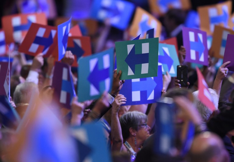 SEA OF Hs. Delegates hold up signs of support for Hillary Clinton during Day 2 of the Democratic National Convention at the Wells Fargo Center in Philadelphia, Pennsylvania, July 26, 2016. Timothy A. Clary/AFP