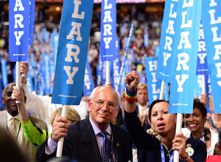 Hillary Clinton supporters watch speakers during the final day of the 2016 Democratic National Convention on July 28, 2016, at the Wells Fargo Center in Philadelphia, Pennsylvania. Robyn Beck/AFP