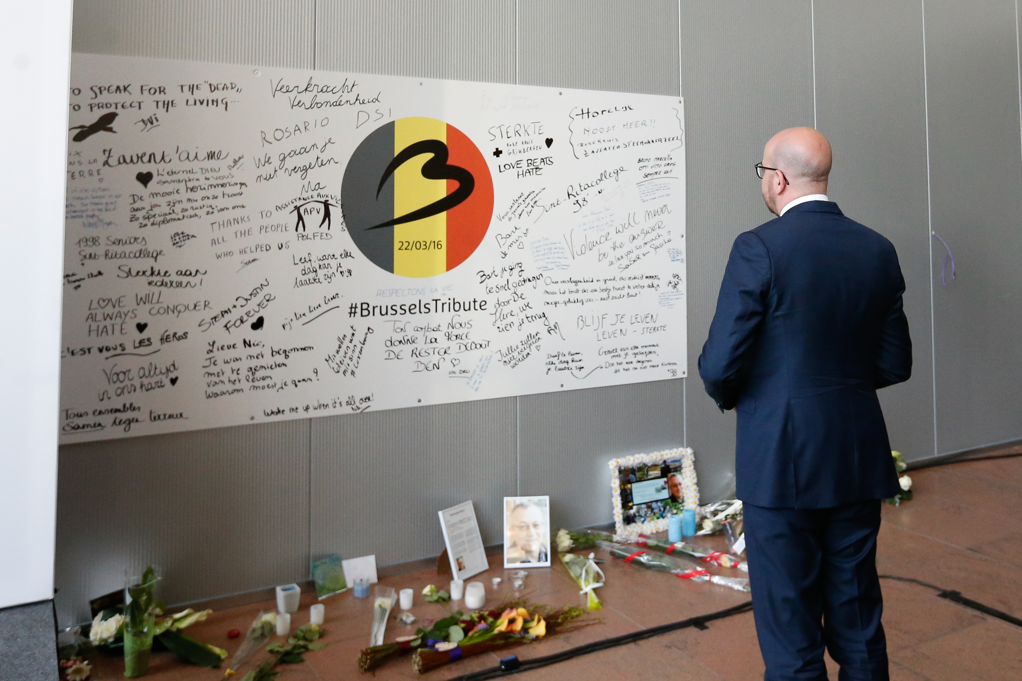 PAYING TRIBUTE. Belgian Prime Minister Charles Michel stands in front of a wall in memory of the bombing victims, May 1, 2016. Photo by Laurent Dubrule/EPA