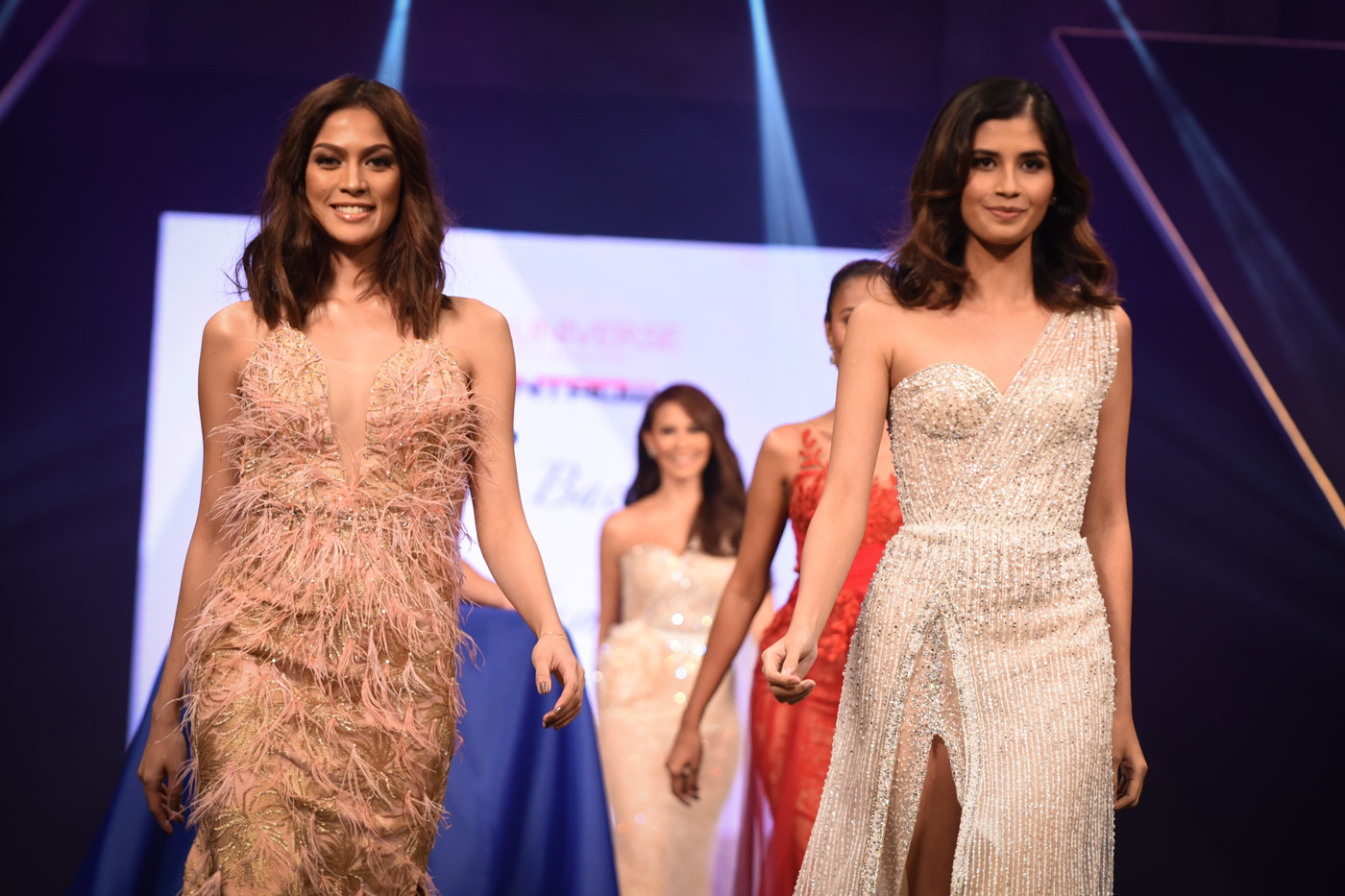 PINOY PRIDE. Former Miss Universe Philippines title holders Ariella Arida and Shamcey Supsup walk the runway.