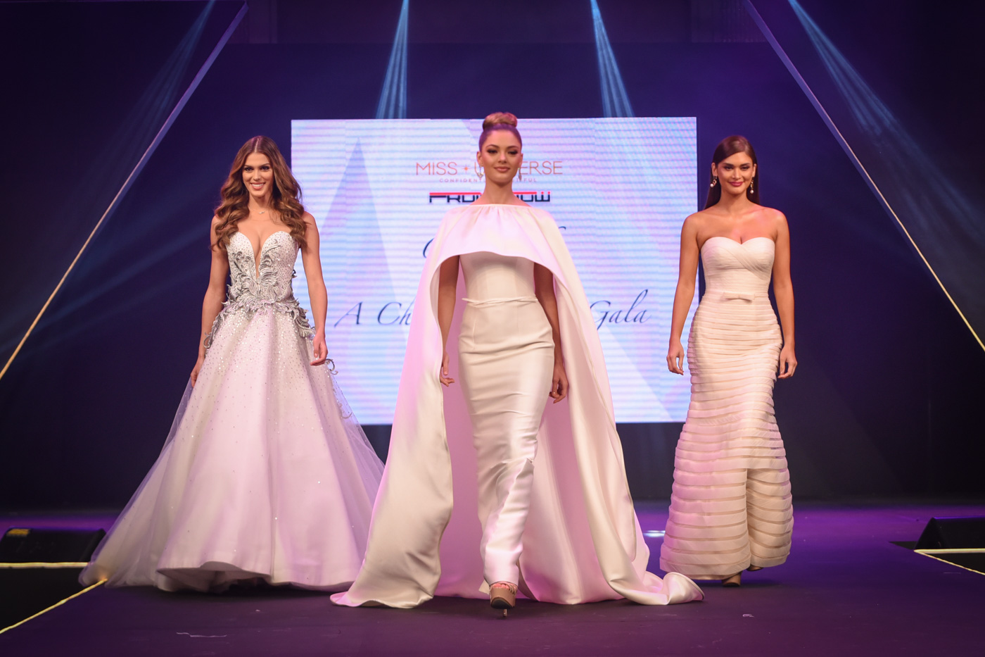 Iris, Demi-Leigh, and Pia walk together onstage