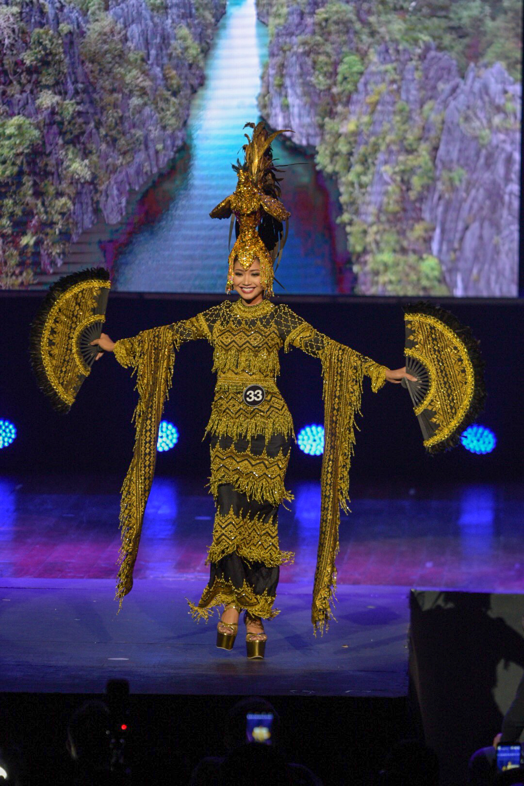 BLACK AND GOLD. Stephanie Abellanida shows her sarimanok-inspired costume during the fashion show.