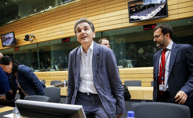 SEEKING A DEAL. Greek Finance Minister Euclid Tsakalotos (C) at the start of a special Eurogroup Finance ministers meeting on Greece, at European Council headquarters in Brussels, Belgium, July 11, 2015. Olivier Hoslet/EPA