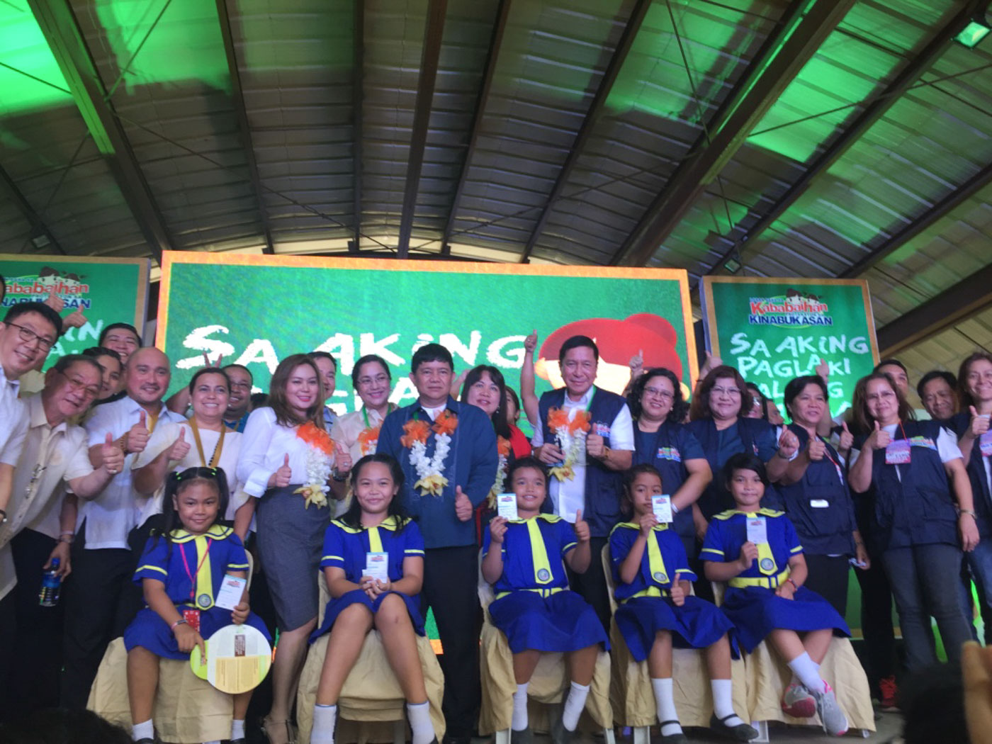 VACCINATED. Mandaluyong Representative Alexandria Gonzales (5th from left), Mayor Carmelita Abalos (6th from left), and Health Undersecretary Gerardo Bayugo (8th from left) pose with schoolgirls after their vaccination. Photo by Mara Cepeda/Rappler
