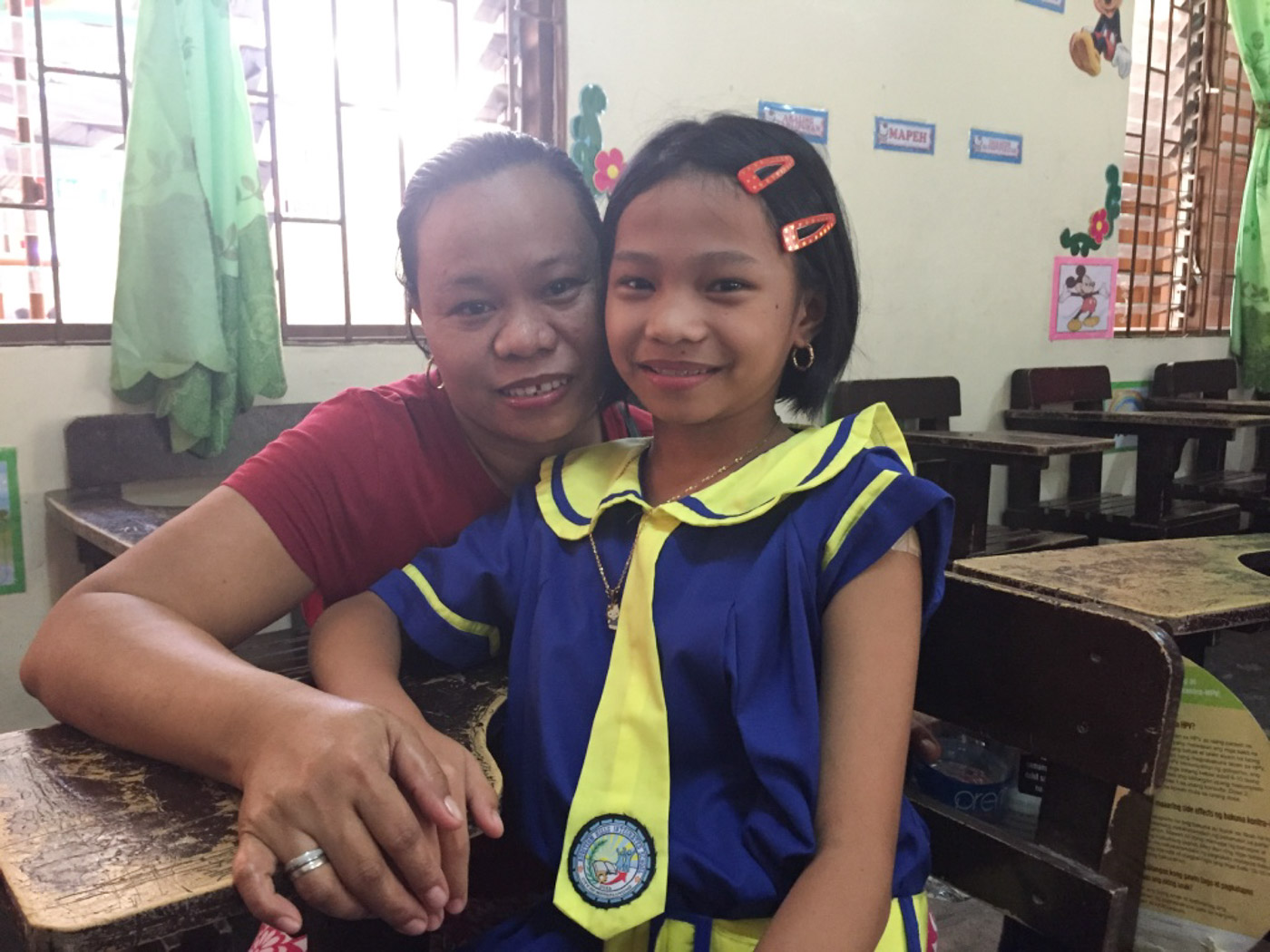 MOTHER AND DAUGHTER. Tehess Alvarez accompanies her daughter Alyssa during vaccination day. Photo by Mara Cepeda/Rappler