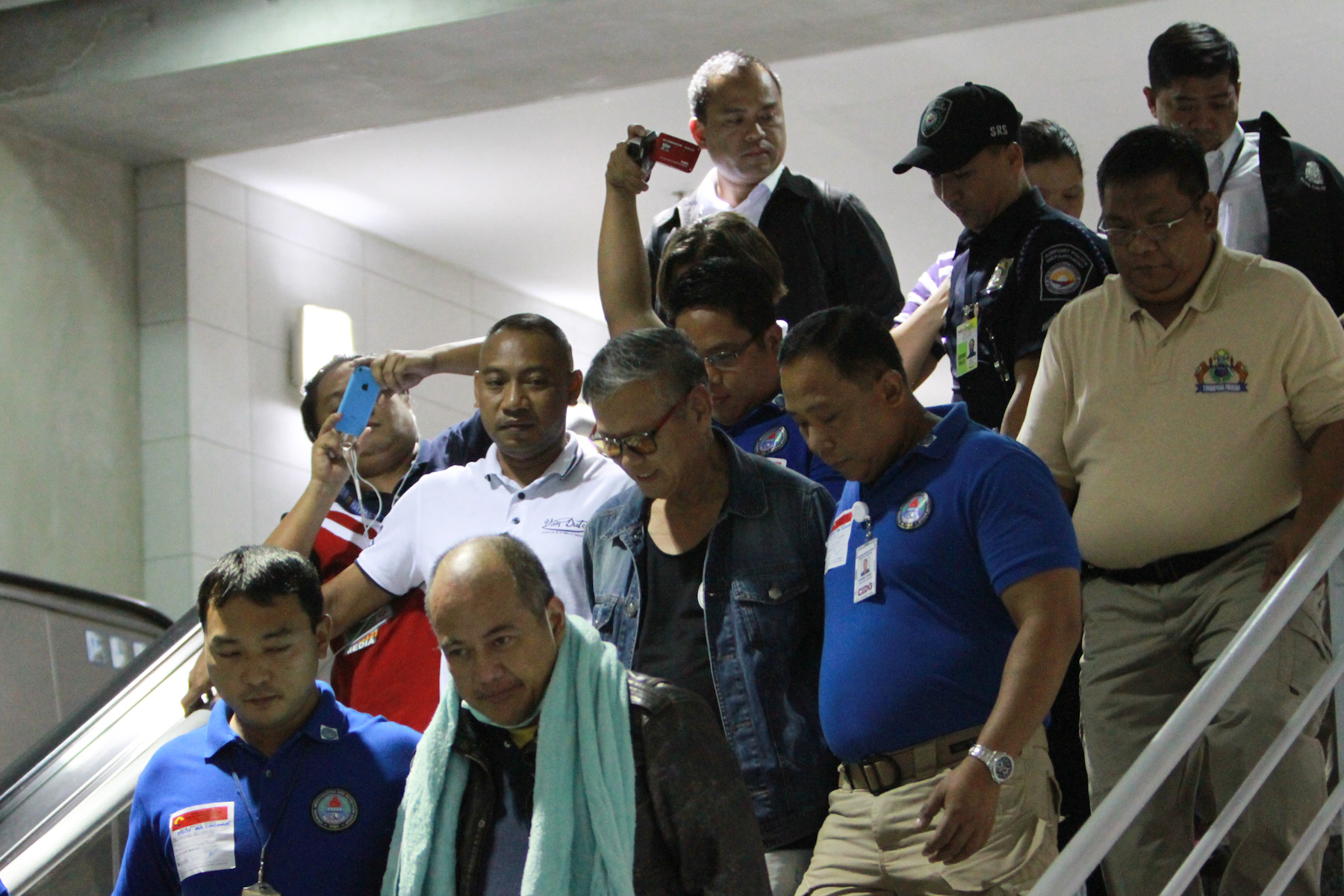IN CUSTODY. The Reyes brothers, who arrived from Thailand early Friday, September 25, are set to be brought to Palawan Friday afternoon. Photo by Czeasar Dancel/Rappler
