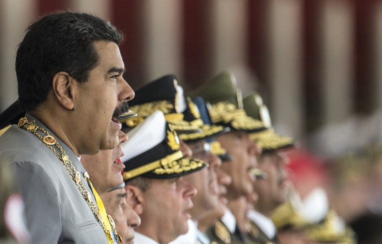 MILITARY BACKING. Venezelan President Nicolas Maduro  and members of the military high command seen during a military parade in Caracas on February 1, 2017. Photo by Juan Barretto/AFP
