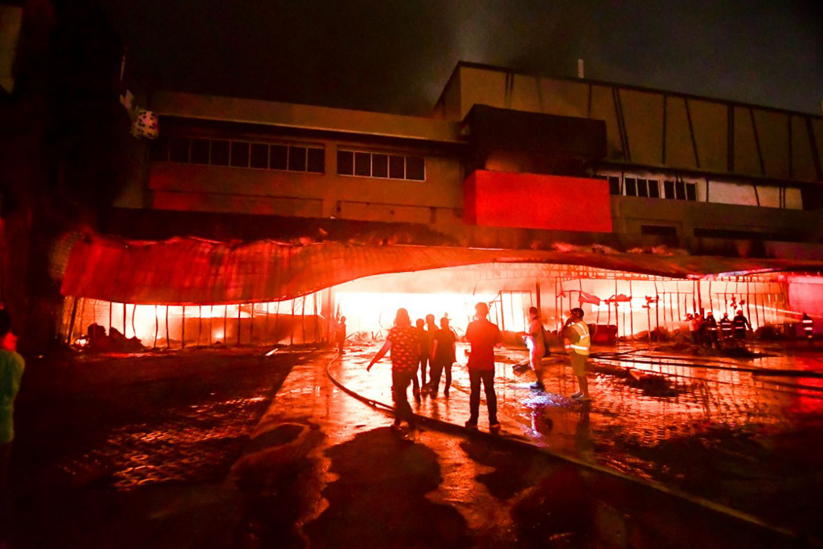 BLAZE. Firemen try to put out a fire inside a mall on October 16, 2019, after a magnitude 6.3 earthquake hit Mindanao. Photo by Edwin Espejo/AFP