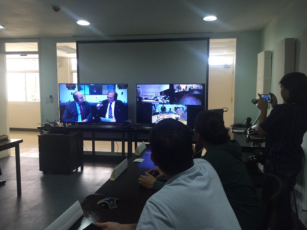 DUAL SCREENS. One screen shows the NASA live stream, while another shows video conference windows of the Diwata-1 team members in Japan. Photo by Shaira Panela