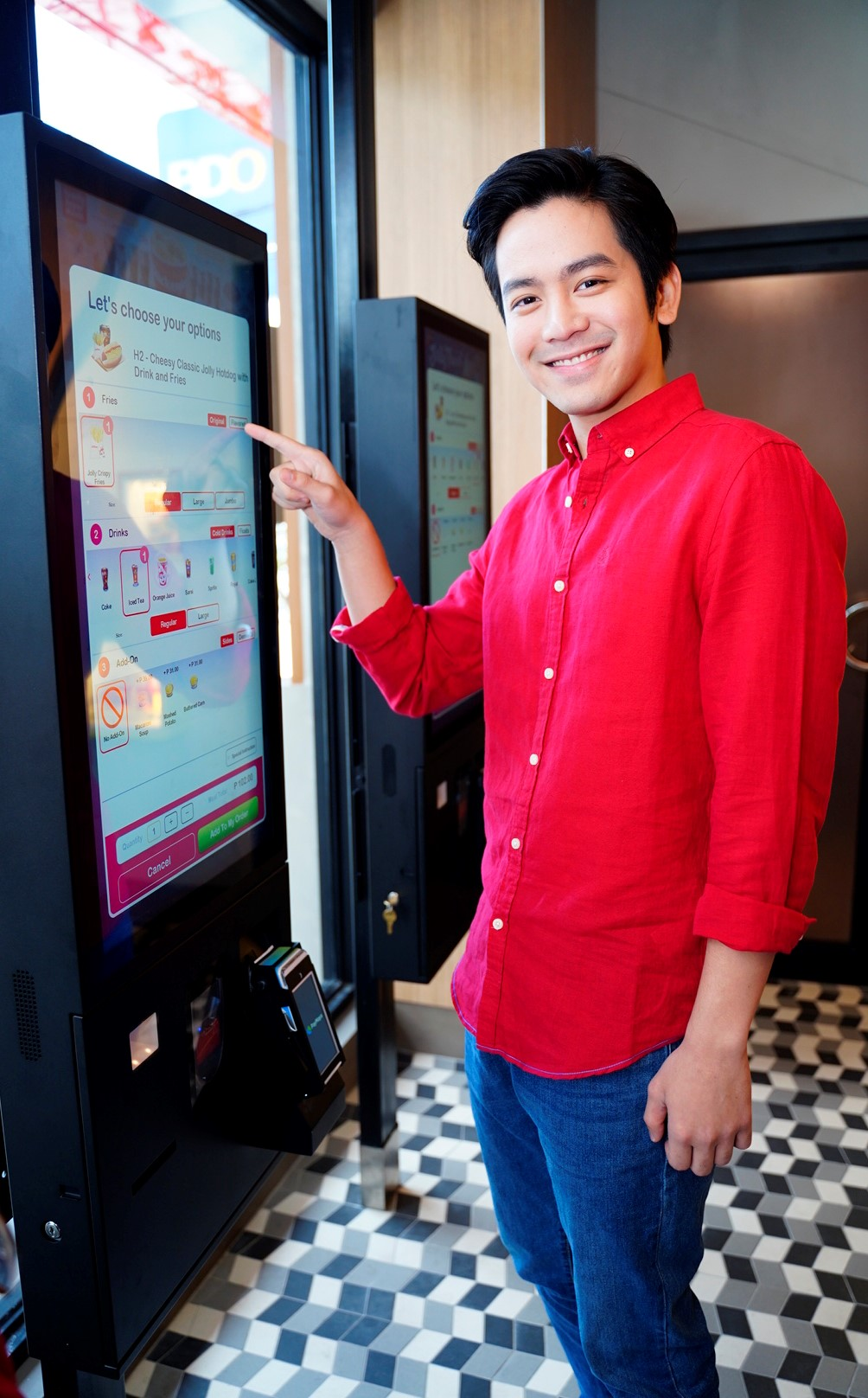 SELF-ORDER KIOSKS. Joshua Garcia tries the self-order kiosk at the Level Up Joy Store in Katipunan.