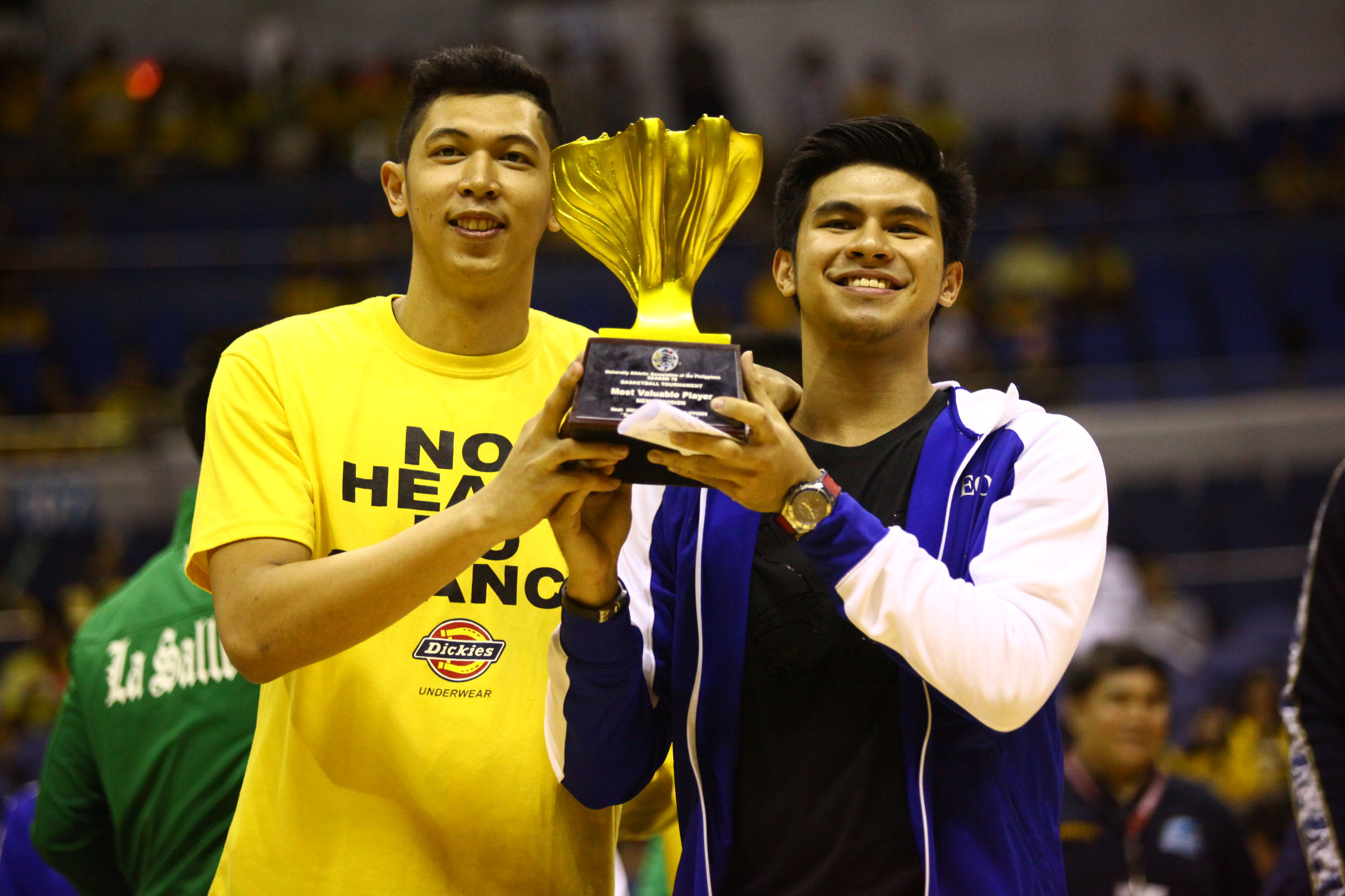 SHARING IS CARING. The top two leaders in the UAAP MVP race lift up the trophy. Photo by Josh Albelda/Rappler