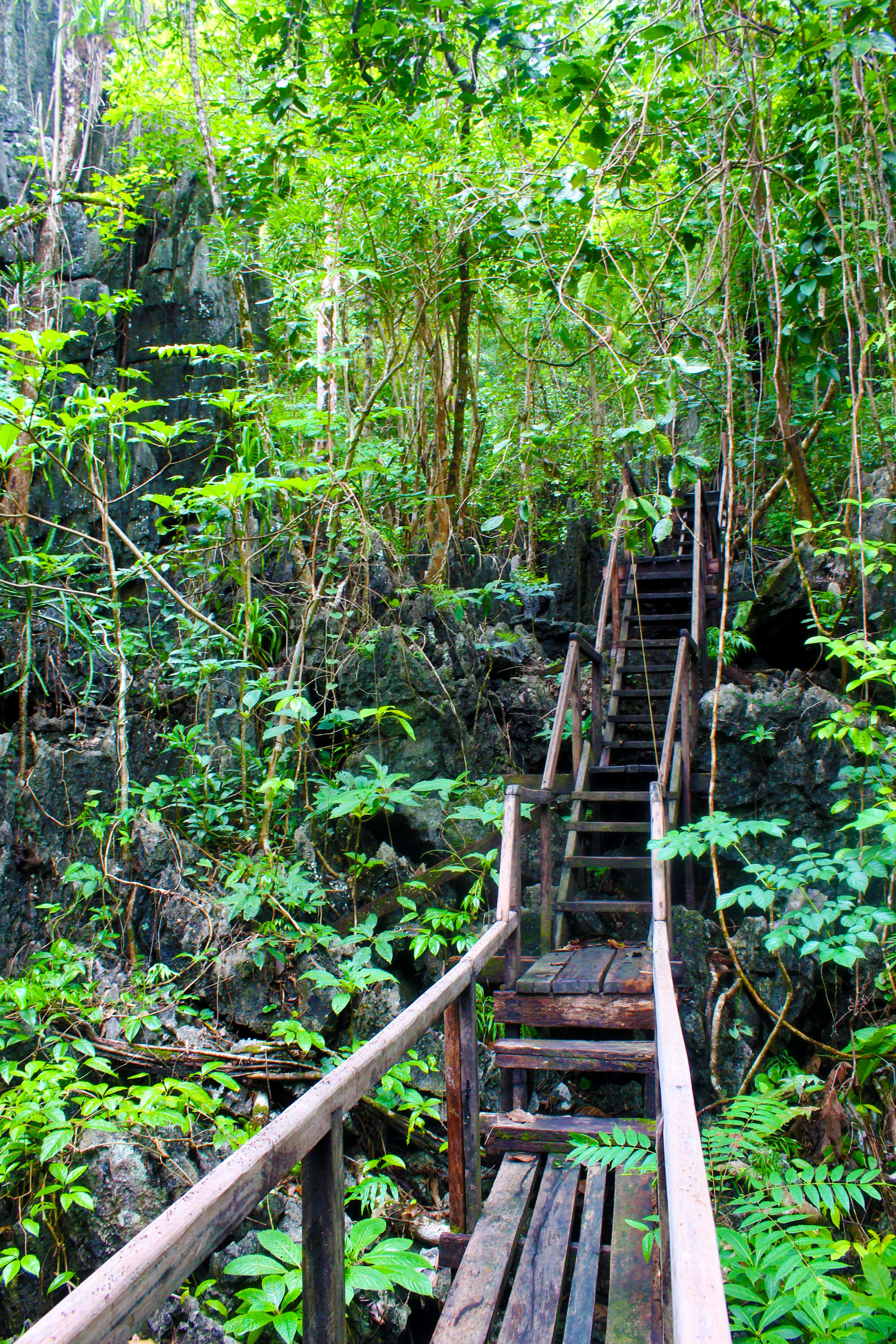 WATCH YOUR STEPS. Crossing through this wooden boardwalk laid atop and in between the magnificent karst mountain requires visitors extra care. Photo by Keith Anthony Fabro