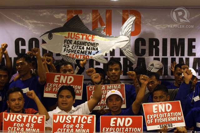 COMPENSATION. Father Rey Ondap (in white shirt) joins calls for giant fishing firm Citra Mina to compensate 43 of its workers it had allegedly abandoned in a detention facility in Indonesia. The workers returned to the country on on February 23, 2015. Photo by Jose Del/Rappler