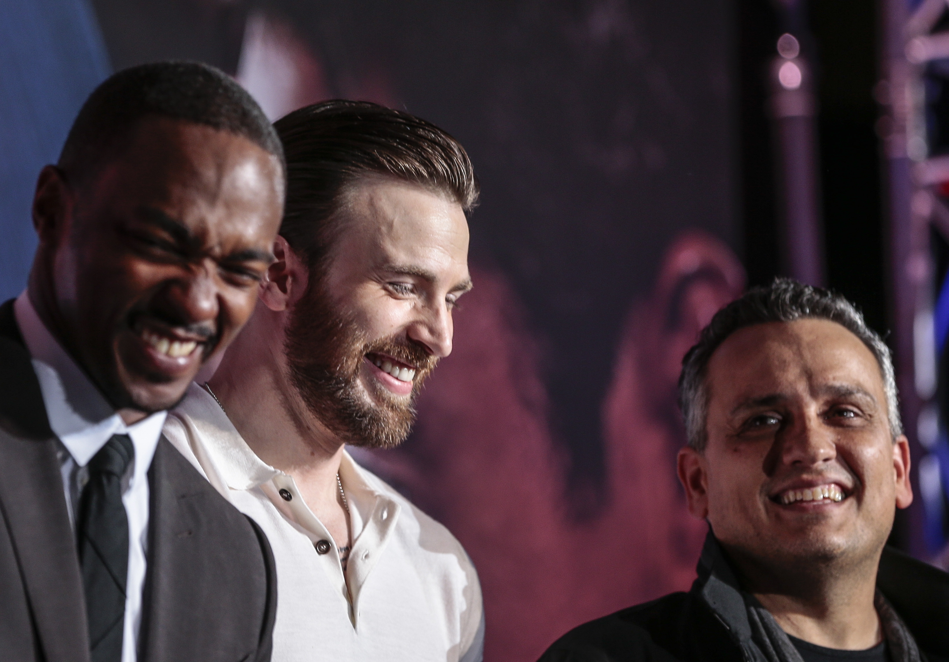 BLUE CARPET. Chris Evans, Anthony Mackie, and director Joe Russo at the premiere of 'Captain America: Civil War' in Singapore. Photo by Wallace Woon/EPA