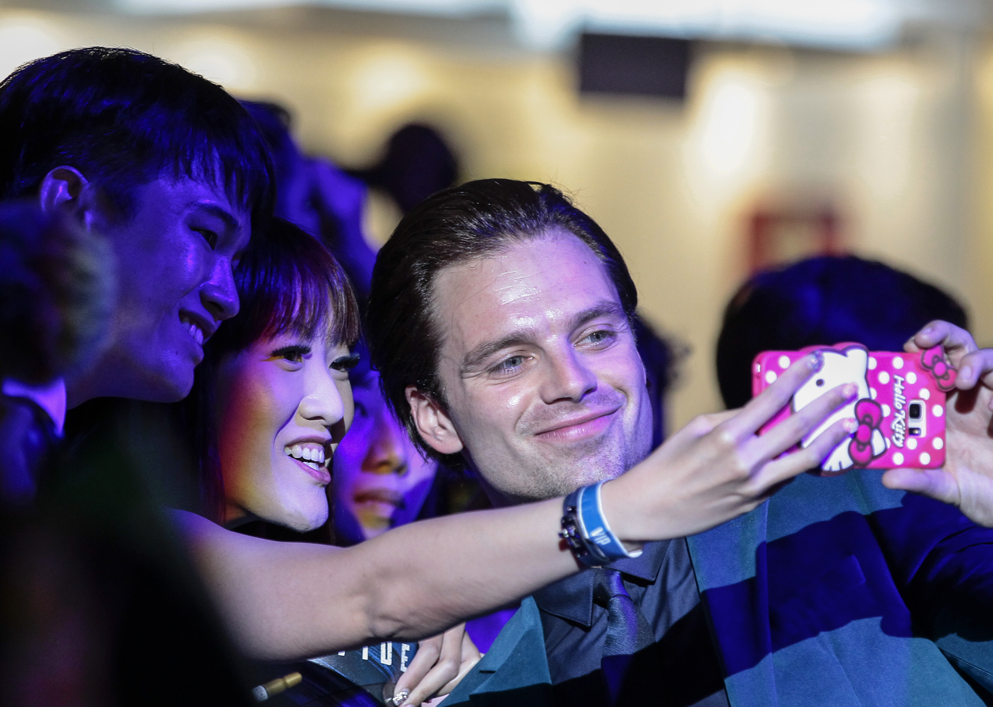 Sebastian Stan with a fan at the 'Civil War' premiere. Photo by Wallace Woon/EPA