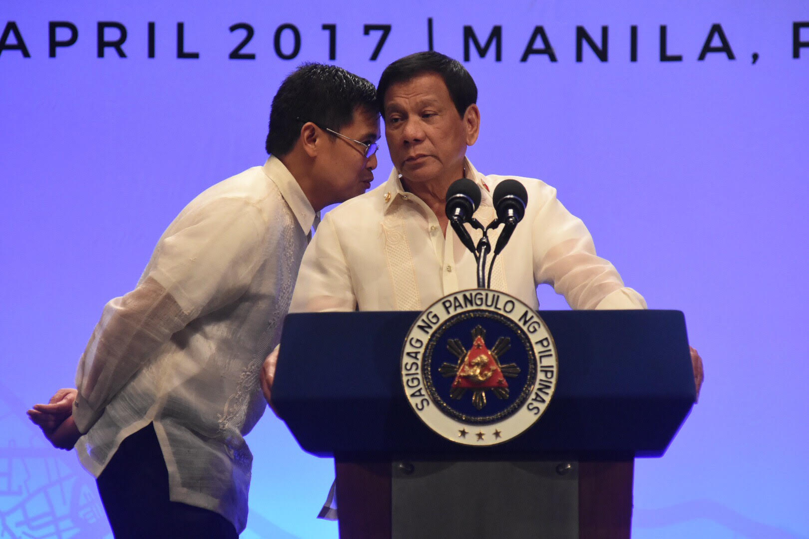 TALKATIVE PRESIDENT. President Duterte only agrees to end his press briefing after being told gala dinner guests can't eat until he arrives. Photo by Angie de Silva/Rappler