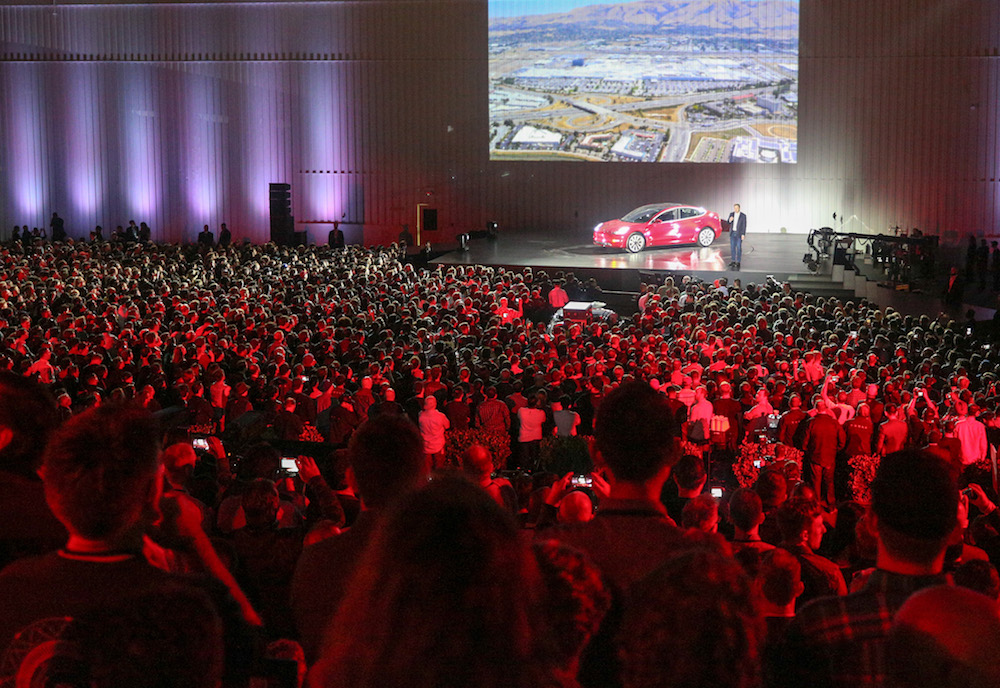 STAR OF THE SHOW. Elon Musk (onstage) speaks during the delivery event for the Tesla Model 3 in California, July 28, 2017. Photo courtesy Tesla Motors