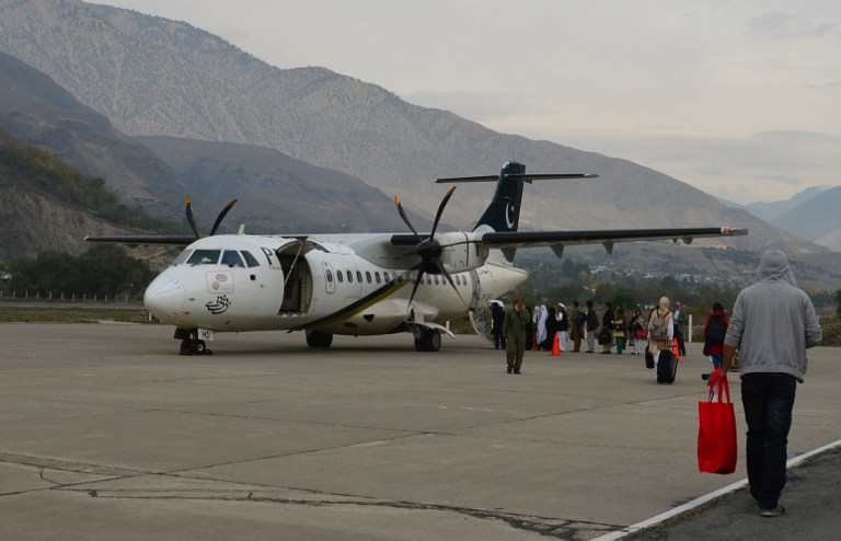 FLAG CARRIER. In this file photo, passengers for a Pakistan International Airlines (PIA) flight line up to board a plane for Islamabad in Chitral on November 1, 2015. A similar type of plane was involved in the December 7, 2016 crash. File Photo Farooq Naeem/AFP