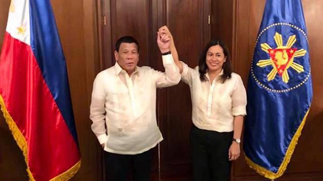 ENDORSEMENT. President Rodrigo Duterte raises the hand of Gertie Duran-Batocabe after a meeting in Malacanang on January 31, 2019. Photo courtesy of Gertie Duran-Batocabe