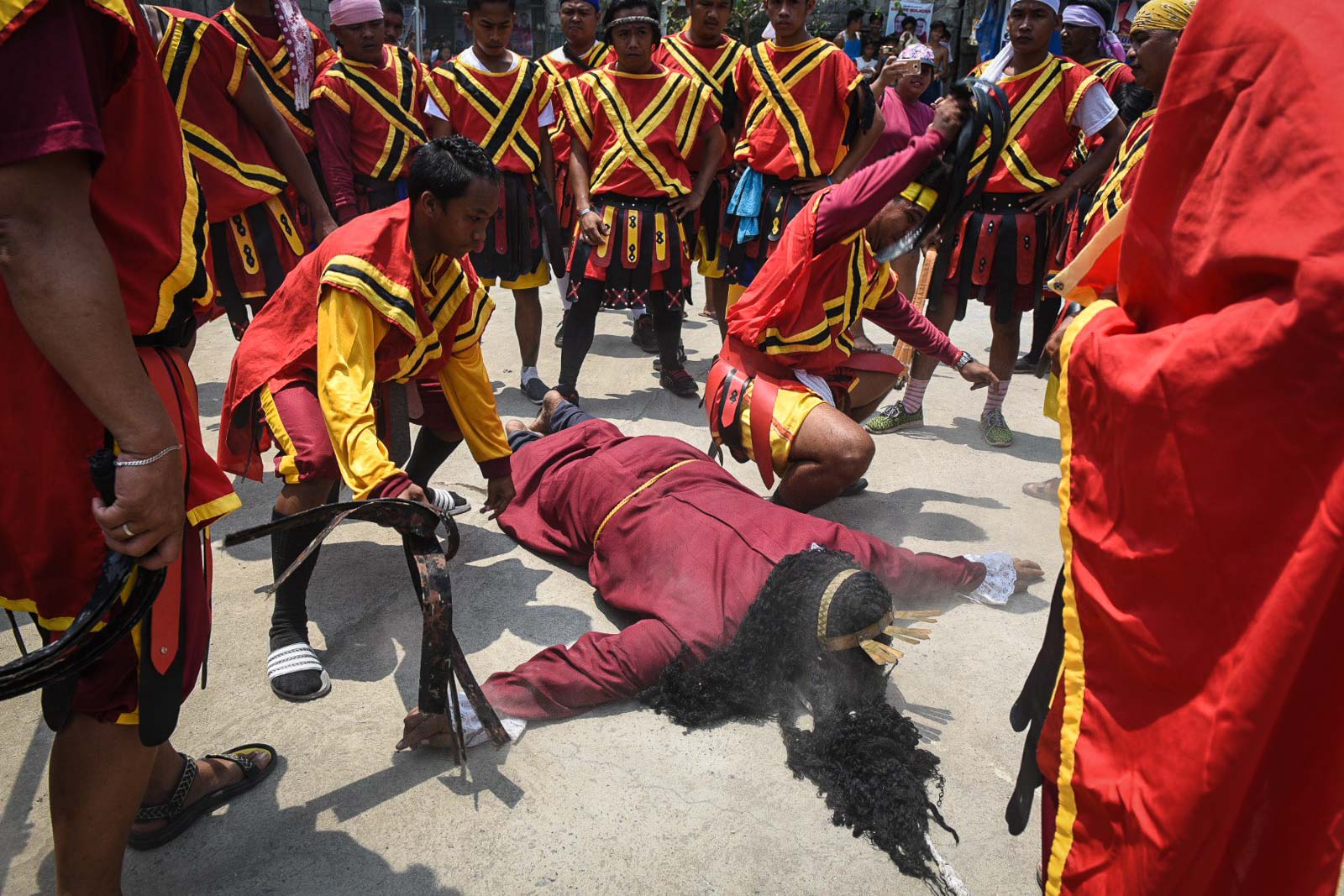 HUDYORES. Passion play Roman soldiers tkae turns in flogging and beating Marcelino before his crucifixion.