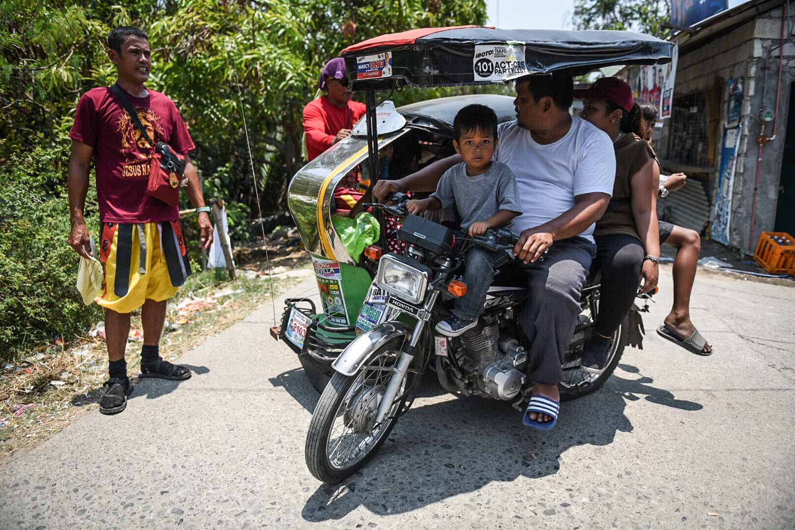 GOING HOME. When all is said and done, the tricycle-driver Marcelino takes his family out for lunch after his crucifixion.