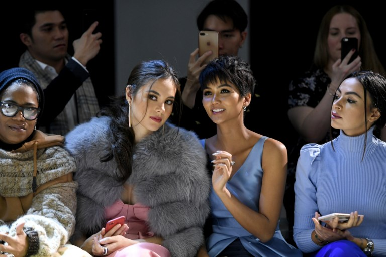 TOGETHER. Miss Universe 2018 Catriona Gray, Miss Vietnam H'Hen Nie and Iman Oubou attend the Phuong My front row during New York Fashion Week: The Shows at Gallery II at Spring Studios on February 12, 2019 in New York City. Photo by Noam Galai/Getty Images for NYFW: The Shows/AFP