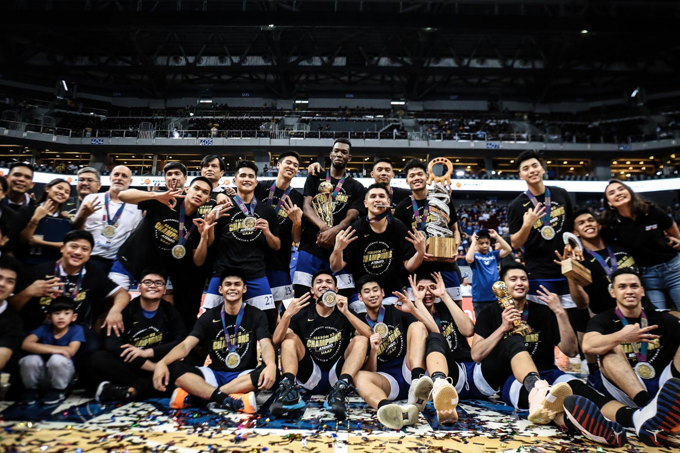 PERFECTION. The Ateneo Blue Eagles flash their trophies and three-peat championship shirts. Photo by Josh Albelda/Rappler