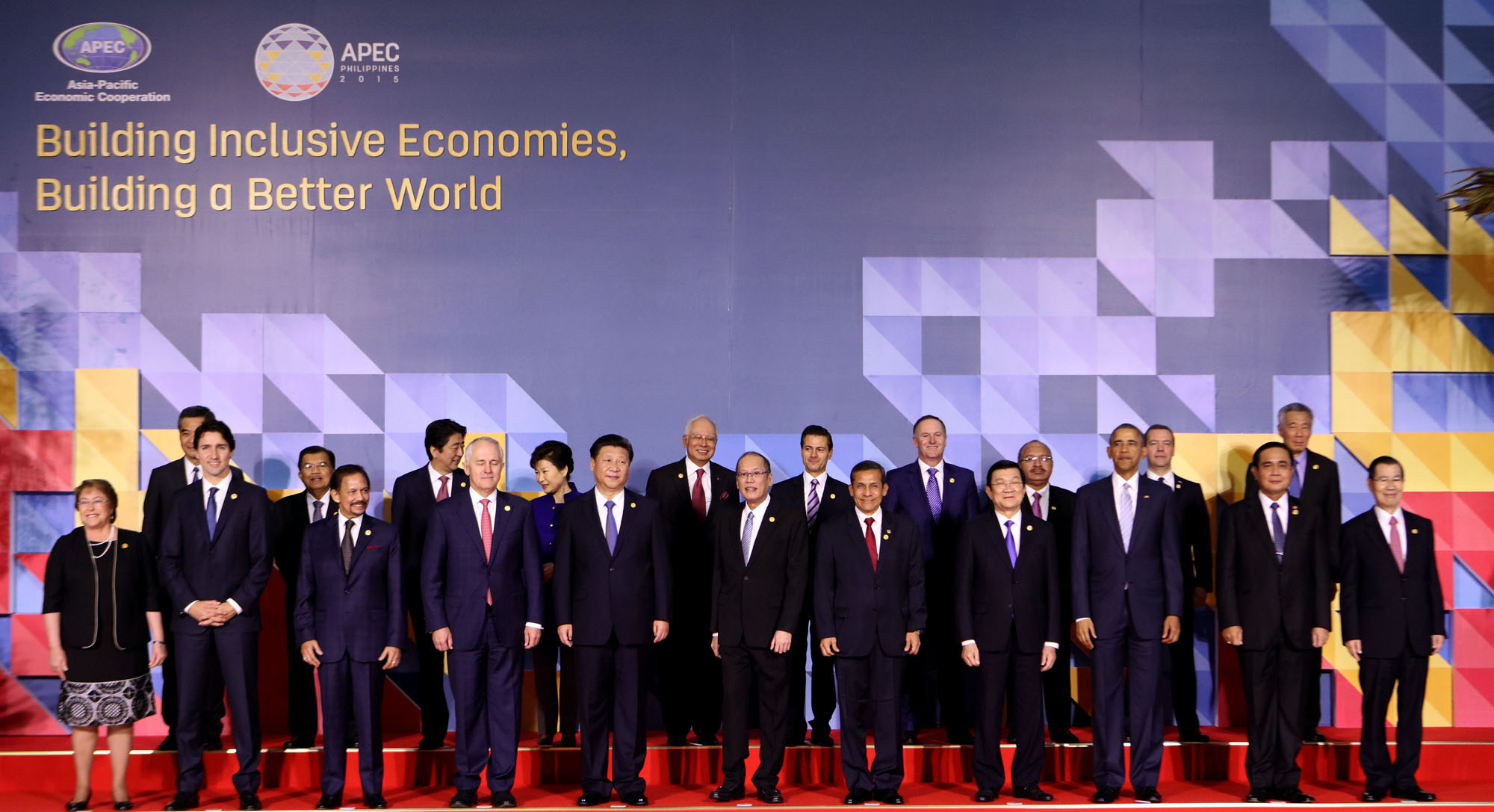 APEC 2015 chairman President Benigno S. Aquino III (6th from left) joins fellow APEC leaders (from left, front row): Republic of Chile President Michelle Bachelet; Canadian Prime Minister Justin Trudeau; Brunei Darussalam Prime Minister Sultan Hassanal Bolkiah; Commonwealth of Australia Prime Minister Malcolm Turnbull; People's Republic of China President Xi Jinping; Republic of Peru President Ollanta Humala; Socialist Republic of Vietnam President Truong Tan Sang; United States of America President Barack Obama; Kingdom of Thailand Prime Minister General Prayut Chan-o-Cha; and Chinese Taipei former Vice President Vincent Siew. (Back row, from left) Hong Kong Chief Executive CY Leung; Republic of Indonesia Vice President Jusuf Kalla; Japanese Prime Minister Shinzo Abe; Republic of Korea President Park Geun-hye; Malaysian Prime Minister Najib Razak; United Mexican States President Enrique Peu00f1a Nieto; New Zealand Prime Minister John Key; Independent State of Papua New Guinea Prime Minister Peter O'Neill; Russian Federation Prime Minister Dmitry Medvedev; and Republic of Singapore Prime Minister Lee Hsien Loong. Photo by Rey Baniquet / Malacau00f1ang Photo Bureau