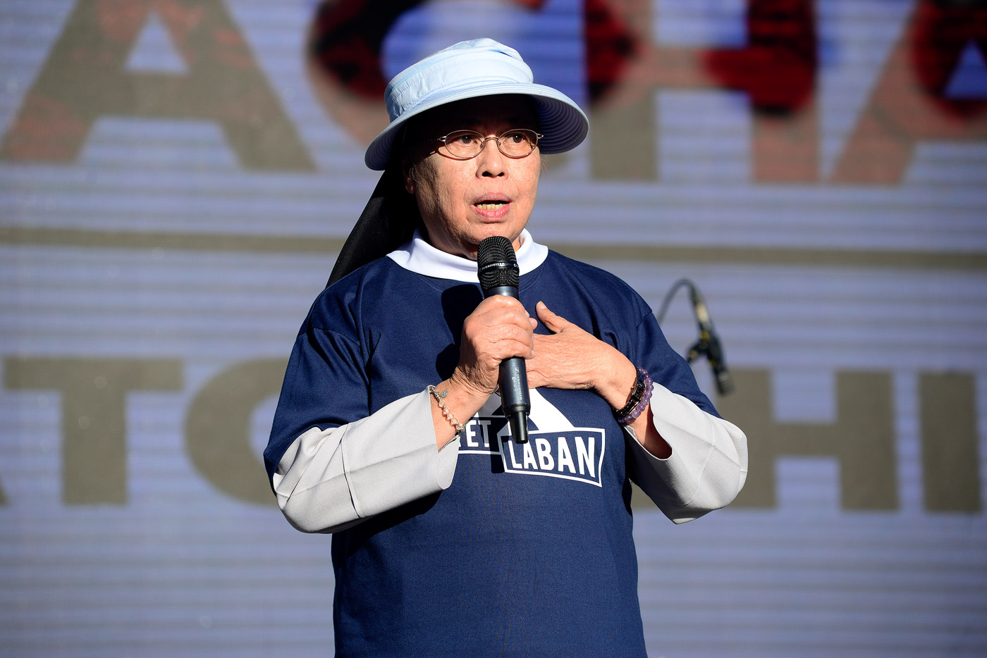 Sister Mary John Mananzan takes the stage at the rally. Photo by Maria Tan/Rappler