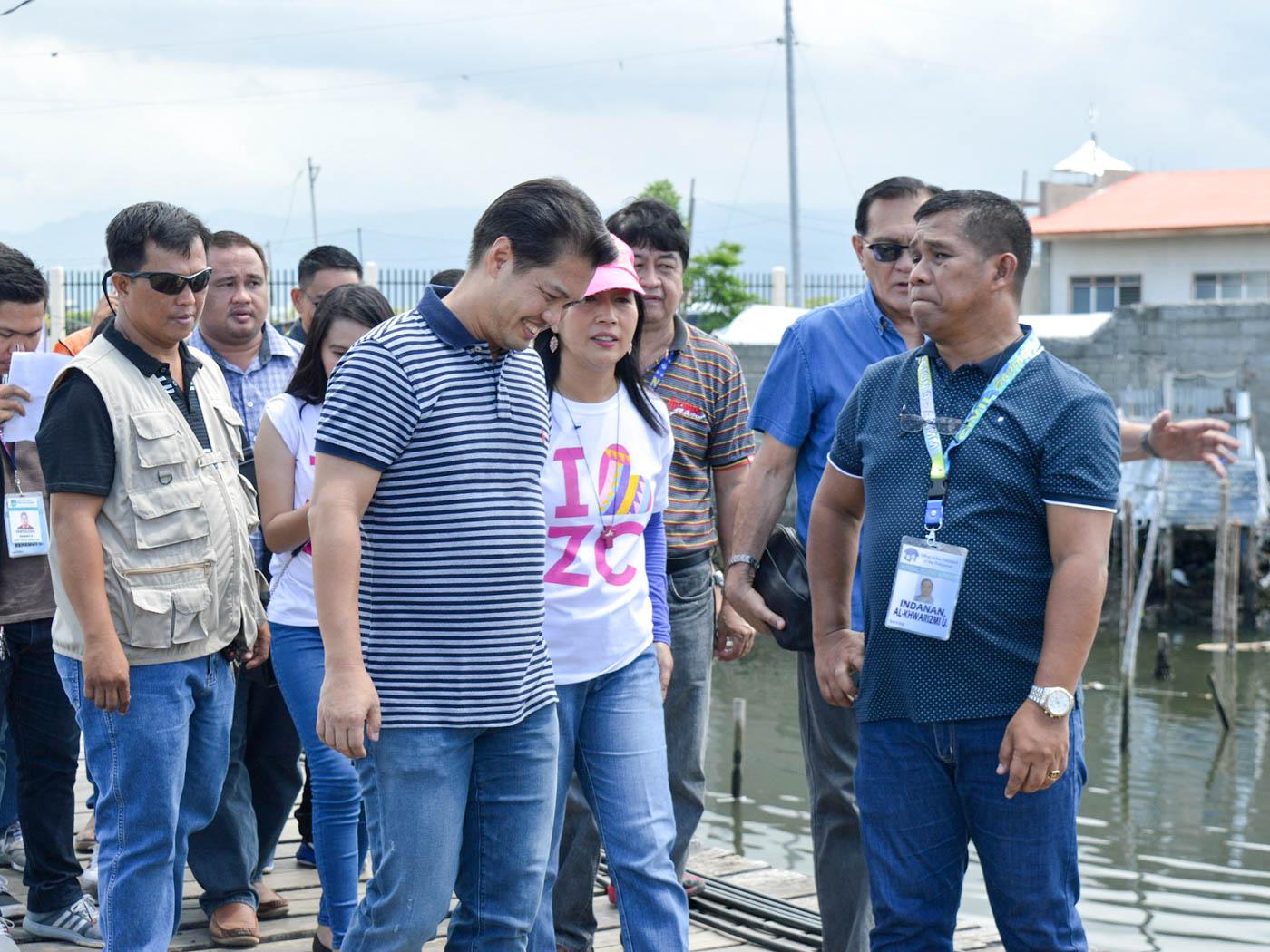iNSPECTION. From left: Negros Occidental Representative Albee Benitez (in stripes), Zamboanga City Mayor Beng Climaco, and Zamboanga City Representative Celso Lobregat (partly hidden, in blue)