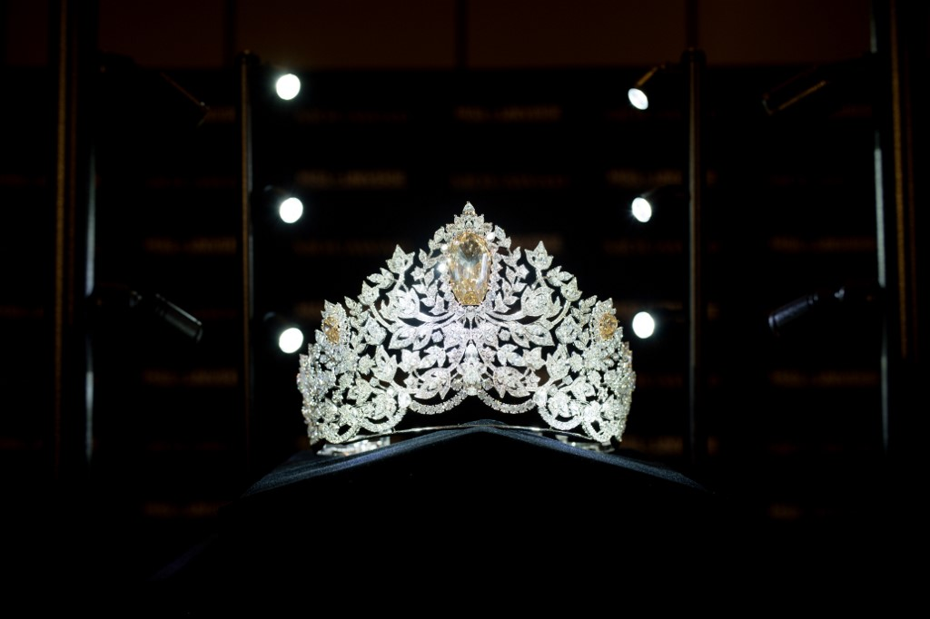 POWER OF UNITY CROWN.  The 'Power of Unity'crown is crafted in 18-karat gold, handset with more than 1770 diamonds including a magnificent centerpiece shield-cut golden canary diamond weighing 62.83-carats. The crown marks the first collaboration between Mouawad and Miss Universe. Photo by Marcus Ingram/Getty Images for Endeavor/AFP