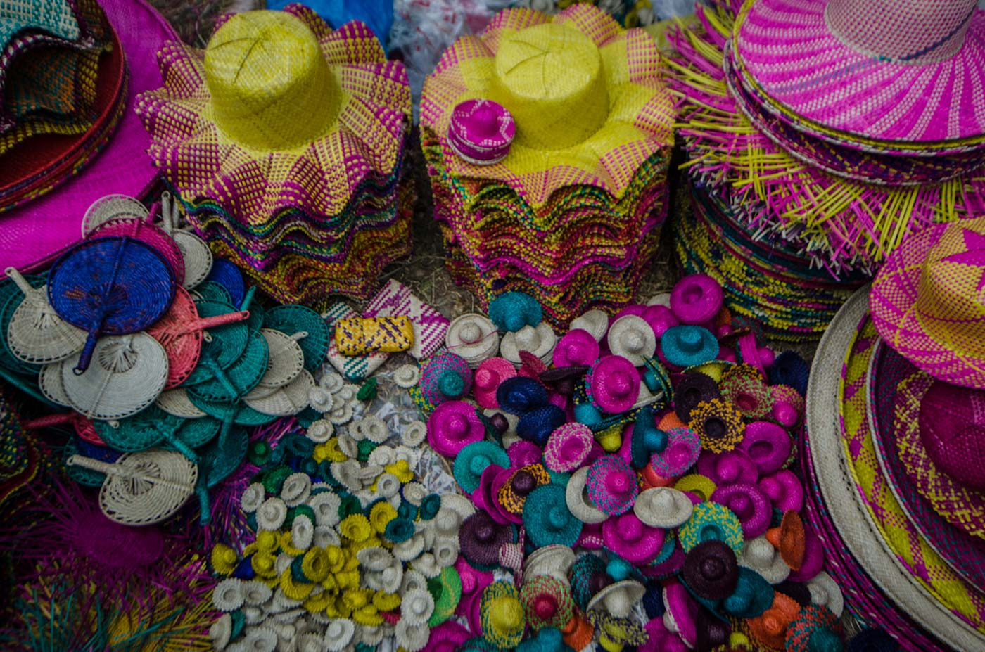 COLORFUL SOUVENIRS. Hats and abanico fans can be bought by tourists for pasalubong