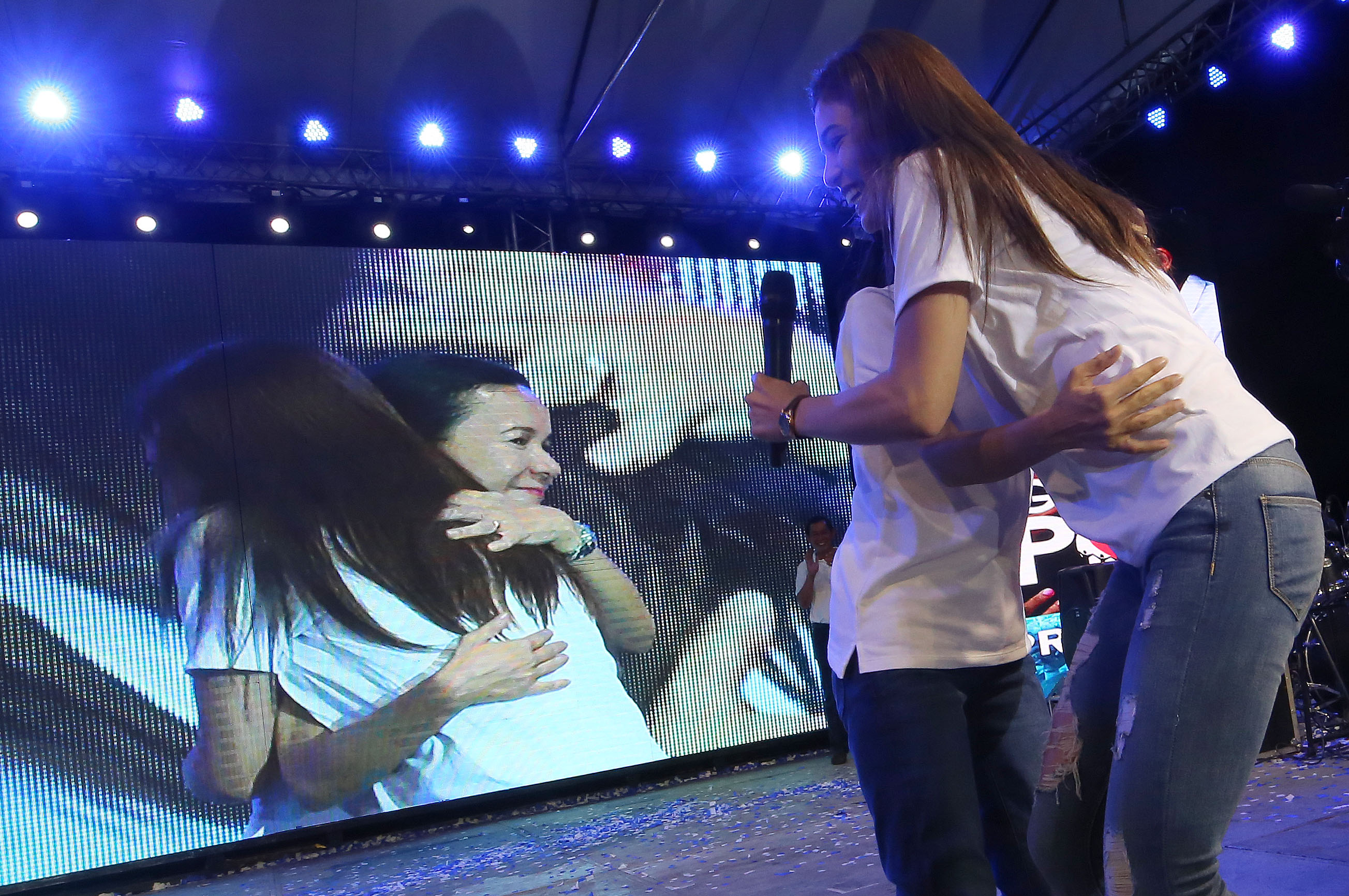 SURPRISE. Presidential candidate Grace Poe hugs her younger sister actress Lovi Poe, who joins her rally in Cagayan de Oro on April 20, 2016. The actress is wearing Poe's campaign shirt and logo. Photo by Jay Morales/Grace Poe Media Bureau