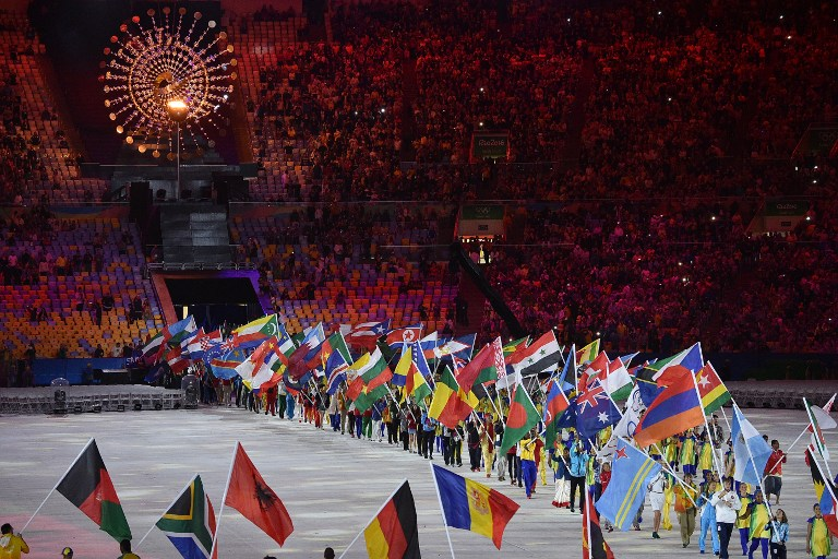 FLAGS GALORE. Athletes parade during the closing ceremony of the Rio 2016 Olympic Games at the Maracana stadium in Rio de Janeiro on August 21, 2016. Luis Acosta/AFP