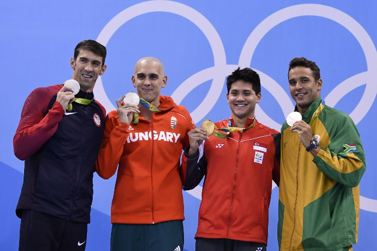WINNERS. Singapore's Schooling Joseph (2ndR) poses with silver medallists (fromL) USA's Michael Phelps, Hungary's Laszlo Cseh and South Africa's Chad Guy Bertrand Le Clos after he won the Men's 100m Butterfly Final during the swimming event at the Rio 2016 Olympic Games at the Olympic Aquatics Stadium in Rio de Janeiro on August 12, 2016. Gabriel Bouys/AFP