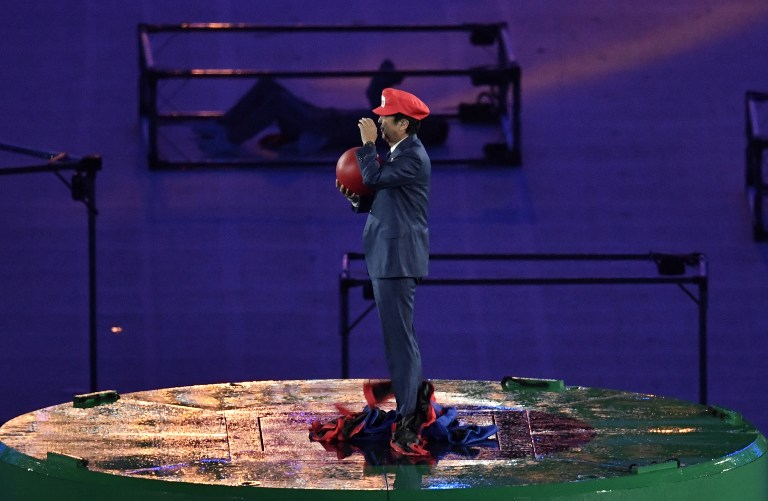 SUPER SHINZO. Japanese Prime Minister Shinzo Abe, dressed as Super Mario, holds a red ball during the closing ceremony of the Rio 2016 Olympic Games at the Maracana stadium in Rio de Janeiro on August 21, 2016. Philippe Lopez/AFP