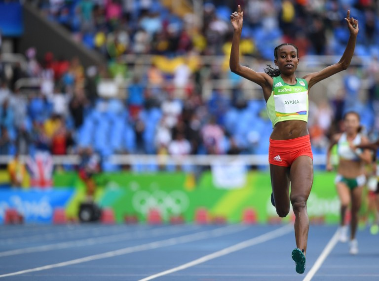 RECORD HOLDER. Ethiopia's Almaz Ayana celebrates after she broke the world record in the Women's 10,000m during the athletics event at the Rio 2016 Olympic Games at the Olympic Stadium in Rio de Janeiro on August 12, 2016. Olivier Morin/AFP