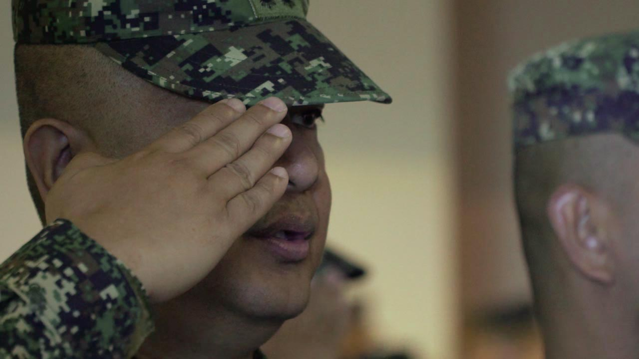 SALUTE. A member of the Philippine Marine Corps sings the National Anthem at the opening ceremony for the KAMANDAG 3 joint military exercises between the Philippines and the US, with Japan also participating. Photo by Nappy Manegdeg/Rappler.com