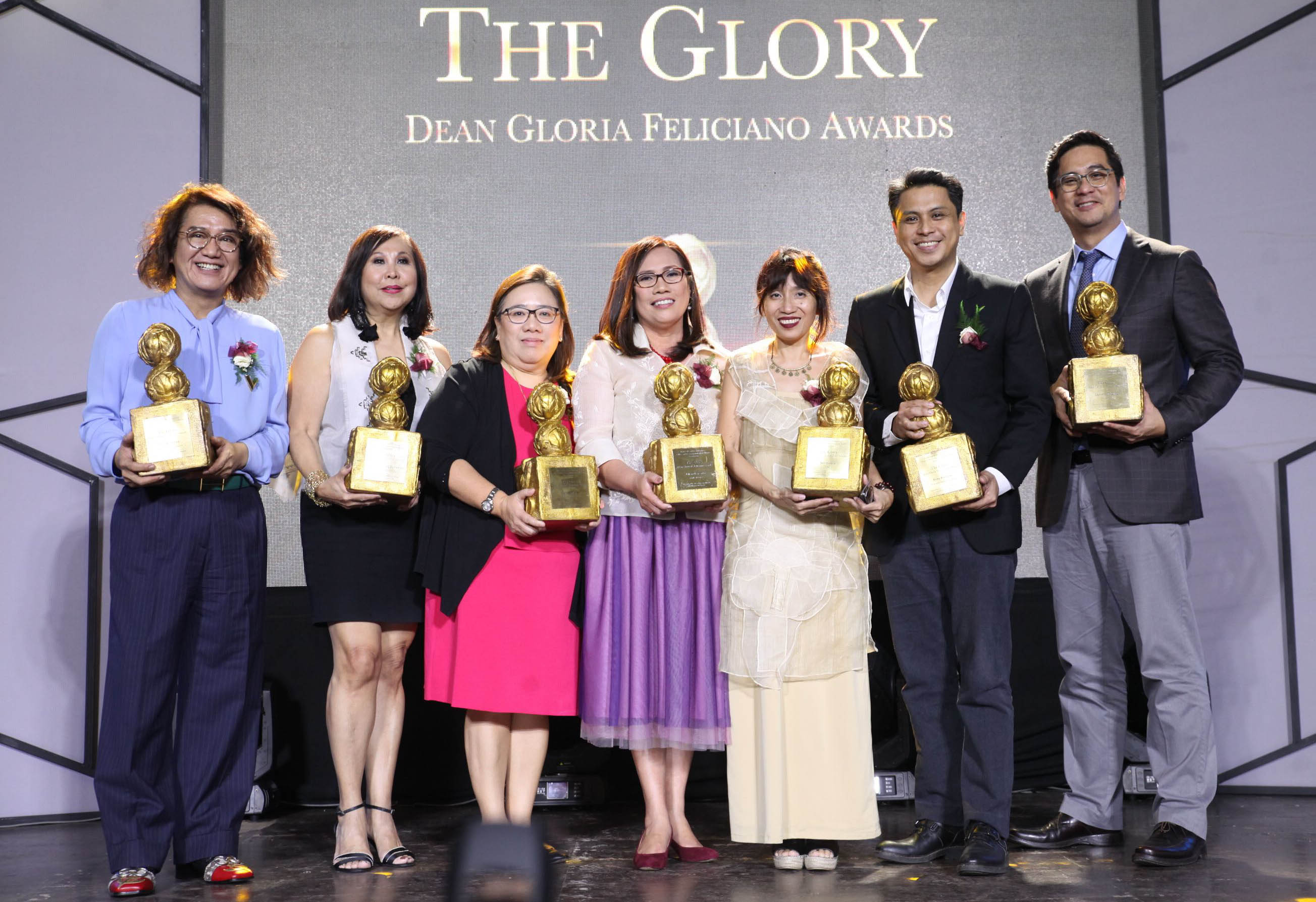 OUTSTANDING ALUMNI. 1st Glory Awards recipients (from left) Raul Castro, Christine Joycelyn Lumawig-Buensalido, Marissa La Torre Flores, Lan Mercado, Sari Raissa Lluch Dalena, Jose Roberto Alampay, and Laurenti Dyogi; not at the event is Jose Hernani David. Photo courtesy of Bernard Testa