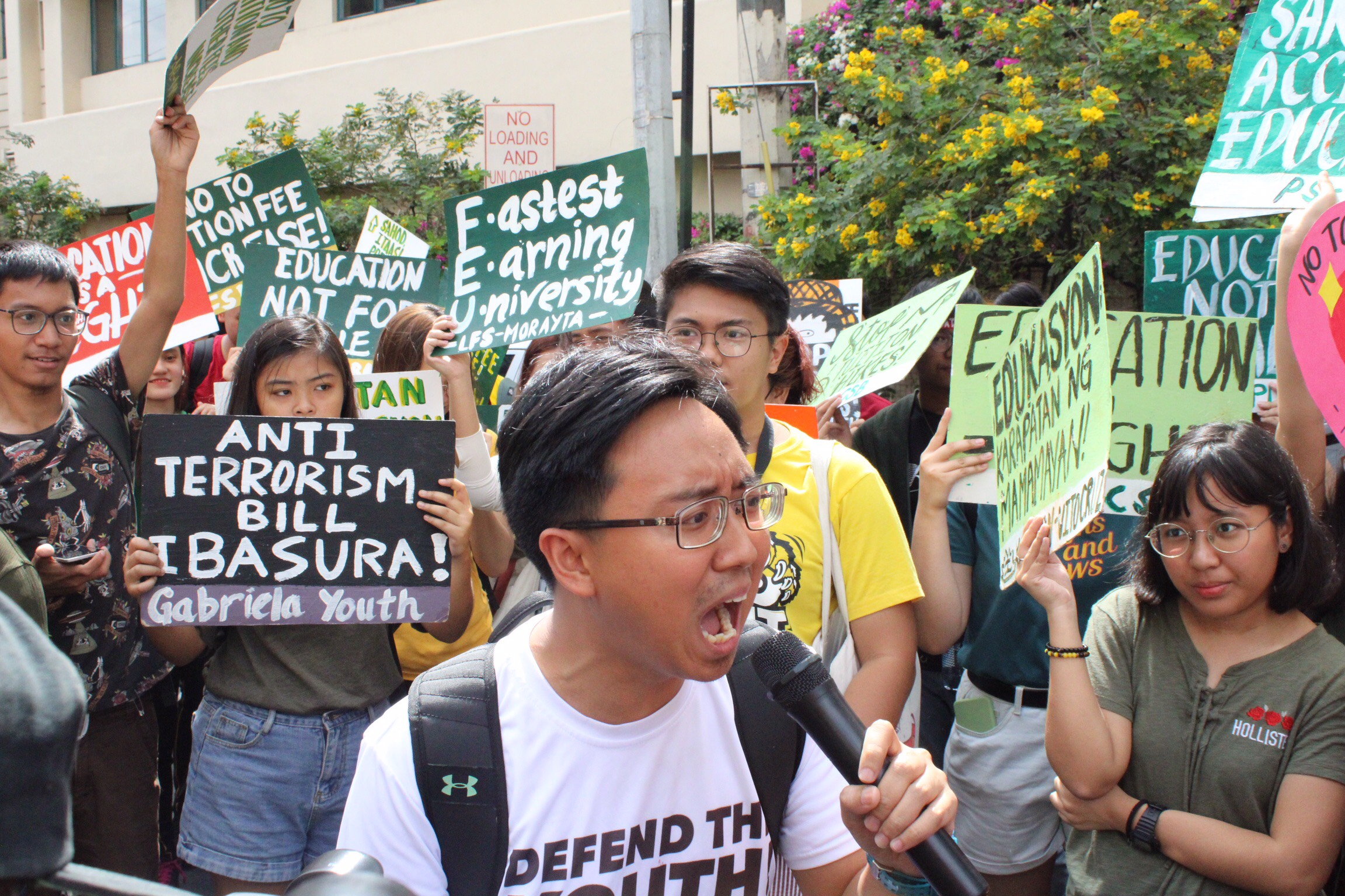 DEFEND. National Union of Students of the Philippines (NUSP) President Raoul Manuel raise his concerns for the proposed tuition fee hike in front of Far Eastern University (FEU) gate. Photo by Kristine Vega