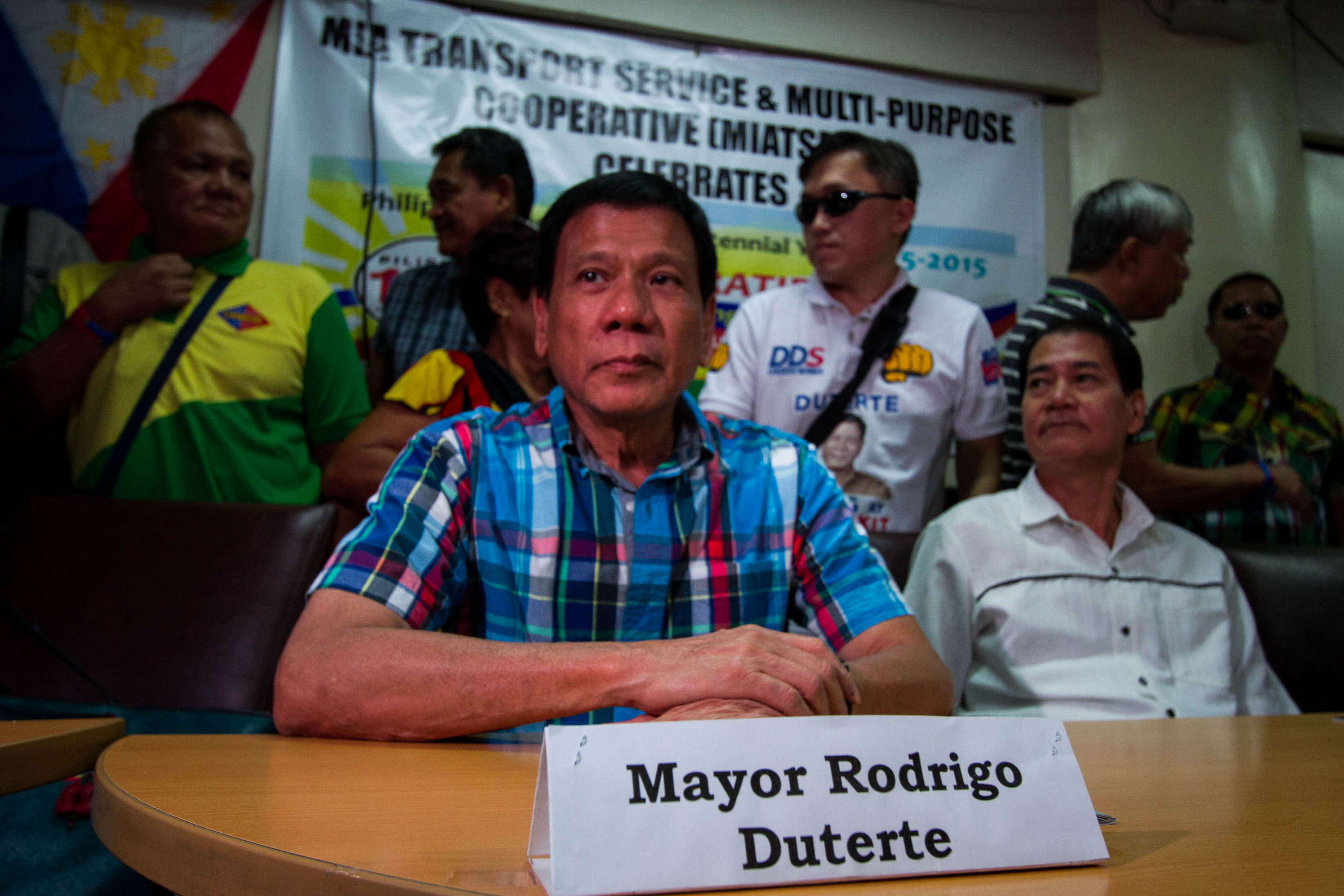 NOT RUNNING? 'I do not covet the presidency. Malayo talaga yan,' says Duterte during a meeting with Naia taxi drivers and operators on June 3. All photos by Mark Saludes/Rappler