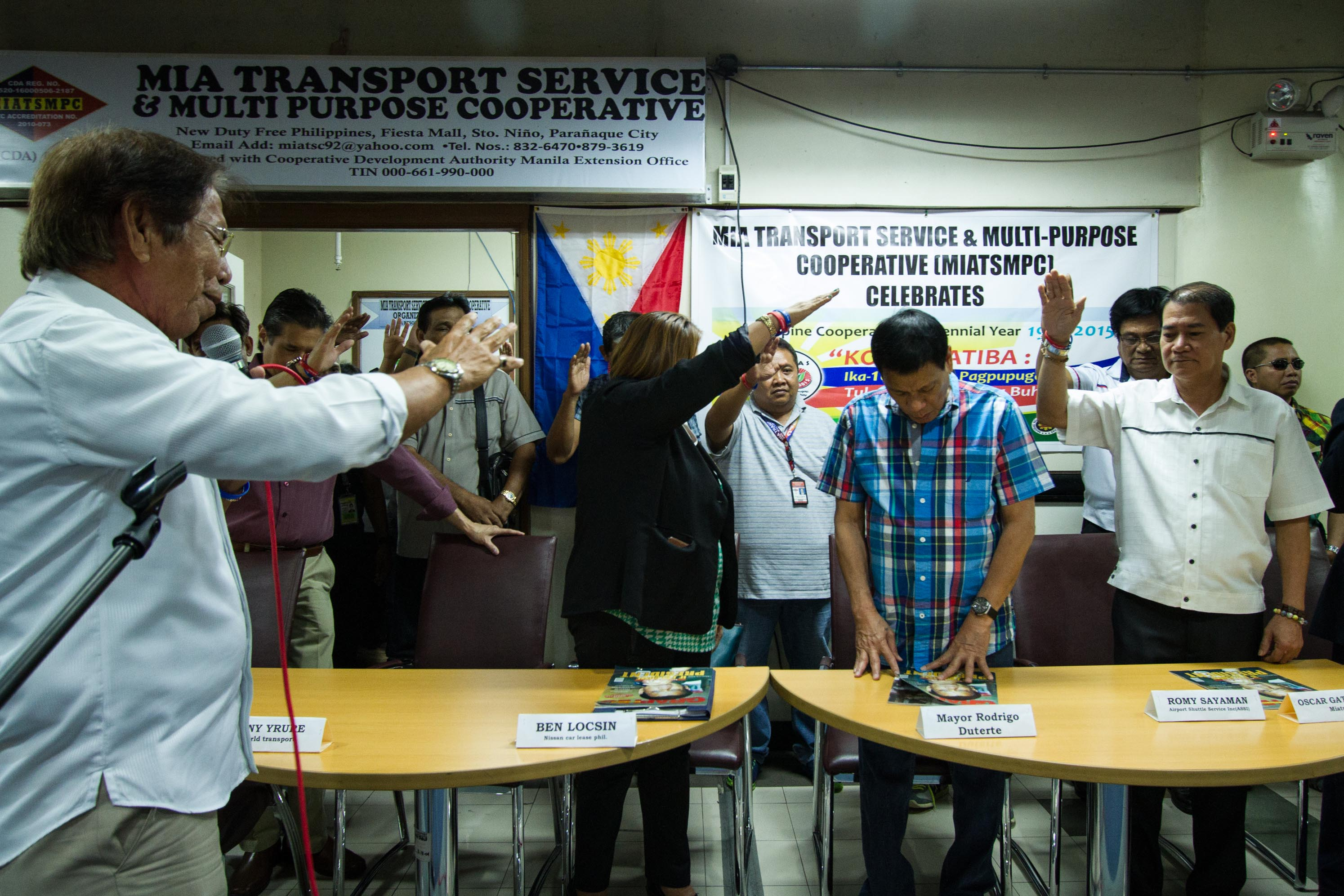 PRAYER. ATCAI members pray over the Davao City mayor during his meeting with drivers and operators at the Duty Free Fiesta Mall in Parau00f1aque City.