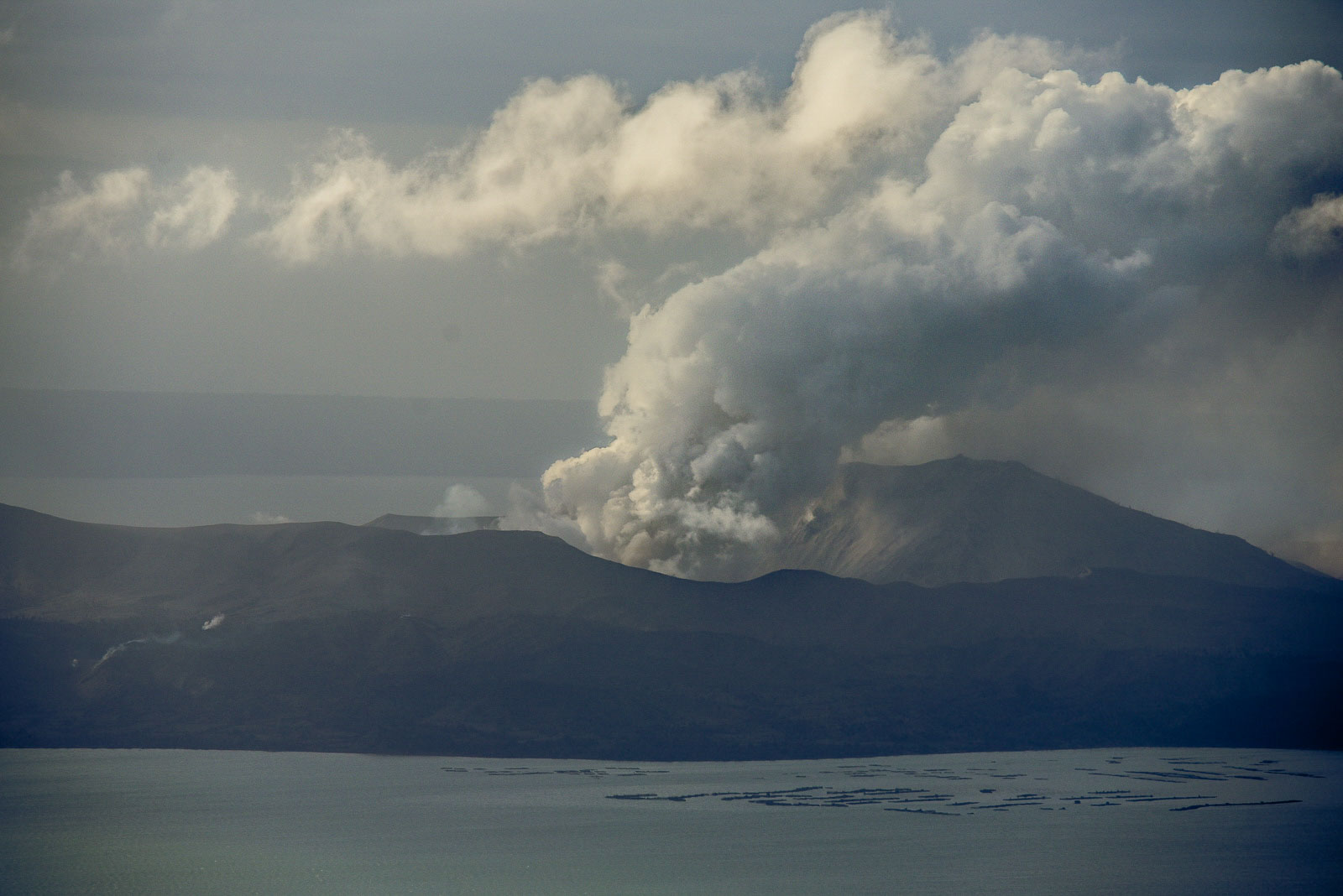 RESTIVE VOLCANO. Taal Volcano spews ash as seen from Talisay, Batangas, on January 15, 2020. Photo by Alecs Ongcal/Rappler