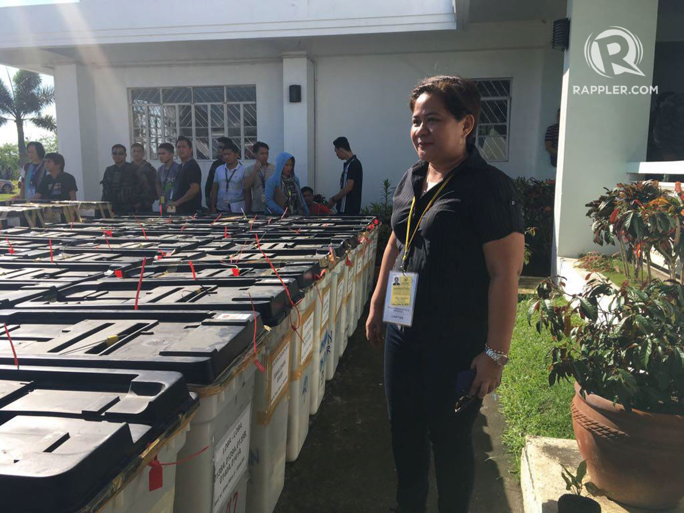 GUARDING THE VOTES. Sardillo stands beside the ballot boxes from Libmanan. Photo by OVP