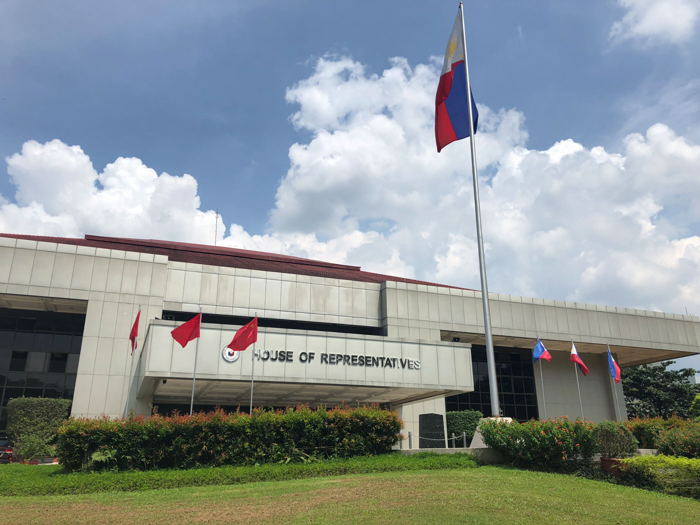 PH-CHINA. Four Philippine flags are raised beside the 3 Chinese flags. Photo by Mara Cepeda/Rappler