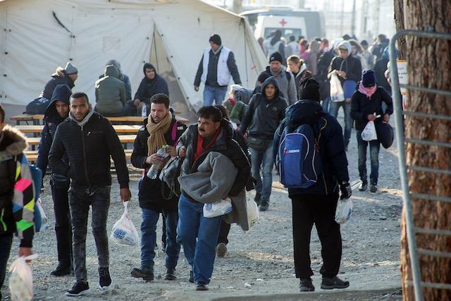 ON DRY LAND. Refugees wait to cross the borders close to Idomeni village, Kilkis, northern Greece, near the border of Greece with FYROM, December 18, 2015. Nikos Arvanitidis/EPA