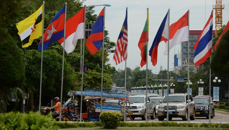 ASEAN COLORS. Cars and tuk-tuk ride past a row of ASEAN member countries' flags in the Laos capital of Vientiane on July 23, 2016, during the country's hosting of the 49th annual ministerial meeting of the South East Asian Nations (ASEAN). Hoang Dinh Nam/AFP