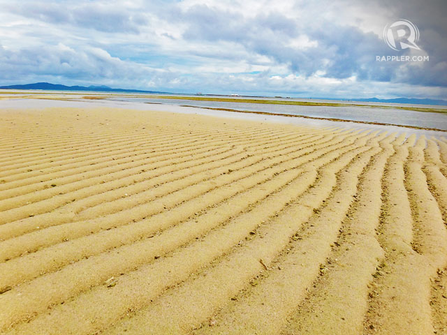 SHAPED BY THE WAVES.  What makes Cagbaleteu2019s sand expanse especially beautiful is its sand ridges. Photo by Rhea Claire Madarang