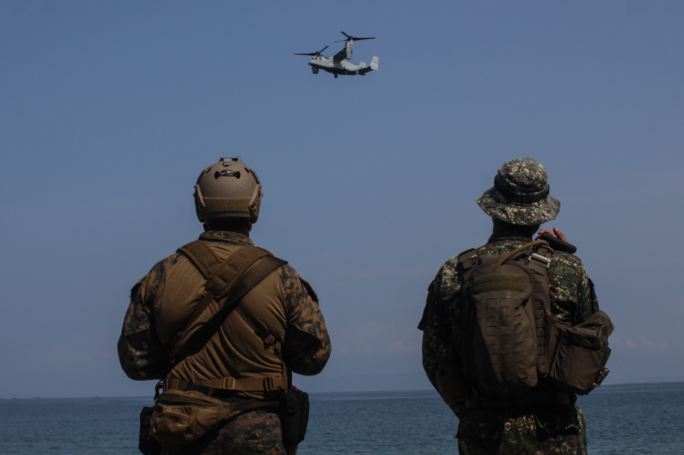 END OF AN ERA? A Filipino marine and his American counterpart watch a US Osprey fly by during a joint military exercise in Ternate, Cavite, in October 2019. Photo by Lito Borras/Rappler